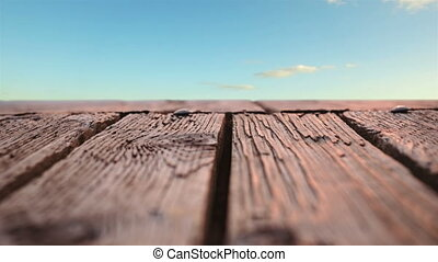 Wooden deck - Low angle of a wooden deck with view of the ...