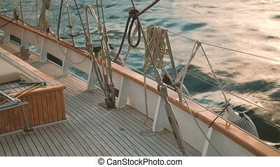 Wooden deck of ship standing at seashore outdoors. Small...