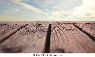Wooden deck with a view of the sky - Low angle of a wooden ...