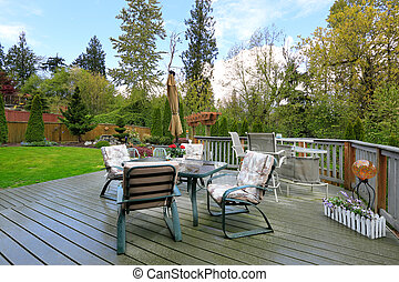 Wooden deck with patio table set