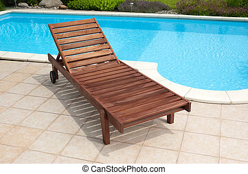 Wooden deckchair - Wooden garden deckchair standing by the...