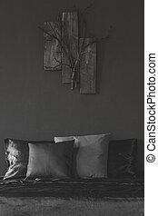 Wooden decor in black bedroom