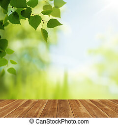 Wooden desk against beauty natural backgrounds for your...