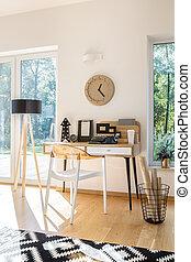 Wooden desk against white wall