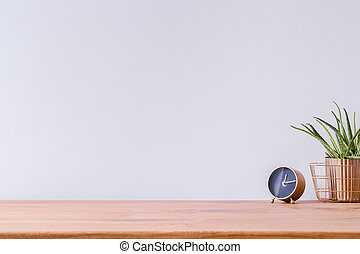 Wooden desk and empty wall