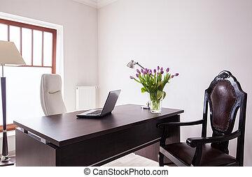 Wooden desk in luxury office