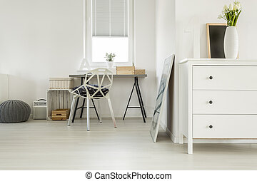 Wooden desk in white room