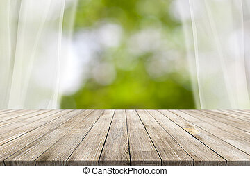 Wooden desk on bokeh blur abstract natural background