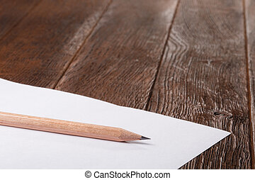Wooden Desk Table, White Clipboard with Blank Paper. Copy space for text or Image