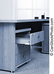 desk with an open drawer