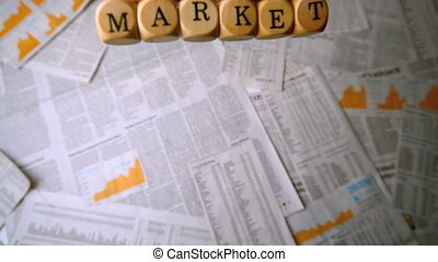 Wooden dice spelling out stock mark