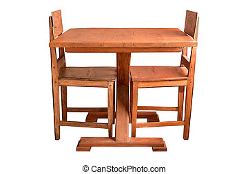Wooden dining table and chairs isolated.