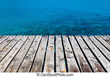 Wooden Dock Besides the Sea - Concept Image of a Wooden Dock...