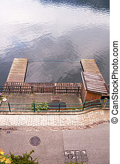 Wooden dock for boats in the city Hallstat, Austria