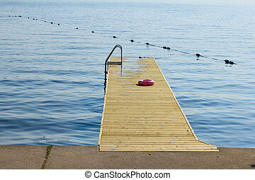 Wooden dock on a blue lake