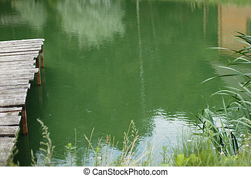 Wooden dock, pier, on a lake in summer day