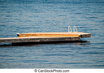 Wooden dock with a white ladder