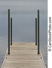 Wooden dock with water in background