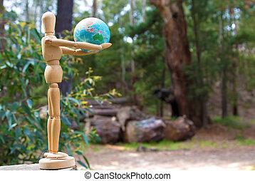 Wooden Doll Man Figure holding earth globe deforestation in Australia concept