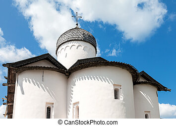 Wooden dome with cross of ancient orthodox church against the blue sky in Novgorod, Russia