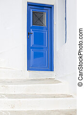 Wooden door and steps in Greece, Europe