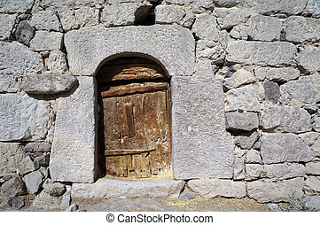 Wooden door and stone wall