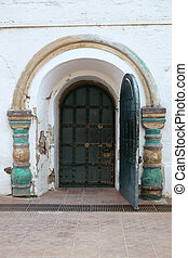 Wooden door and wall with ornament