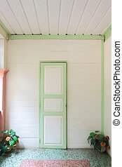 Wooden door by colonial style