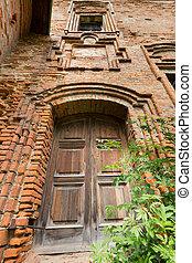 Wooden door in old tower.