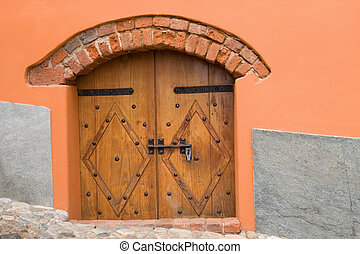 Antique wooden door in exposed wall . Antique wooden door in ...