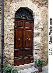 wooden door in Tuscany. Italy