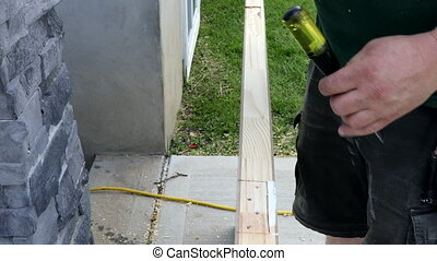 Prepared for mounting on a hinges wooden door installation of a hinge working with chisel