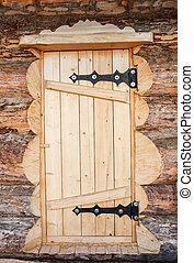 wooden door of log house