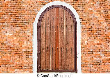 Wooden door on a brick wall.