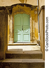 Wooden Door to the Patio in the French City