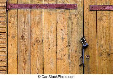 Wooden door with a padlock