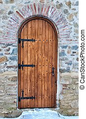 Wooden door with arch