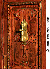 Wooden door with brass knob