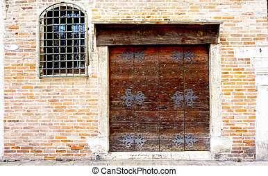 wooden door with brick wall building