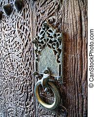 Wooden door with doorhandle