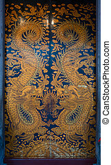 Wooden door with dragon images in Chinese temple - Wooden...