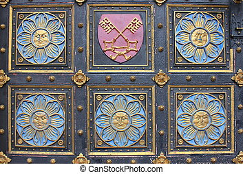 Wooden door with emblems