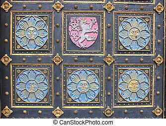 Wooden door with emblems