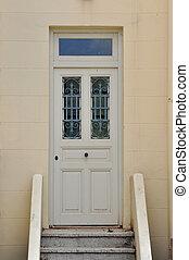 wooden door with iron pattern