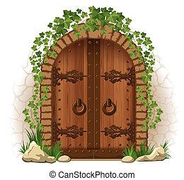 Wooden door with ivy - Arched medieval wooden door in a...