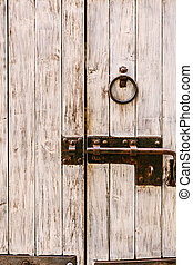 Wooden door with metal bolt and ring handle. High quality ...