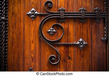 Wooden door with metal decoration