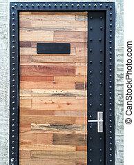 wooden door with metal frame