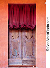 wooden door with red curtain of medieval house