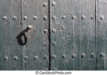 Wooden door with rusty iron lock